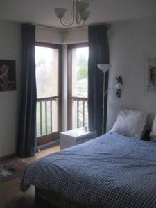 double bedroom with corner windows