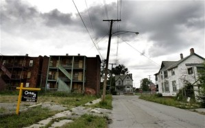 A lot for sale next to abandoned homes in what was once a thriving middle-class area in Detroit Photo: AFP/Getty Images