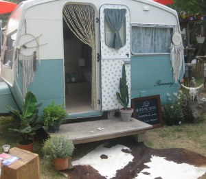 A refurbished caravan makes a charming hideaway in the garden